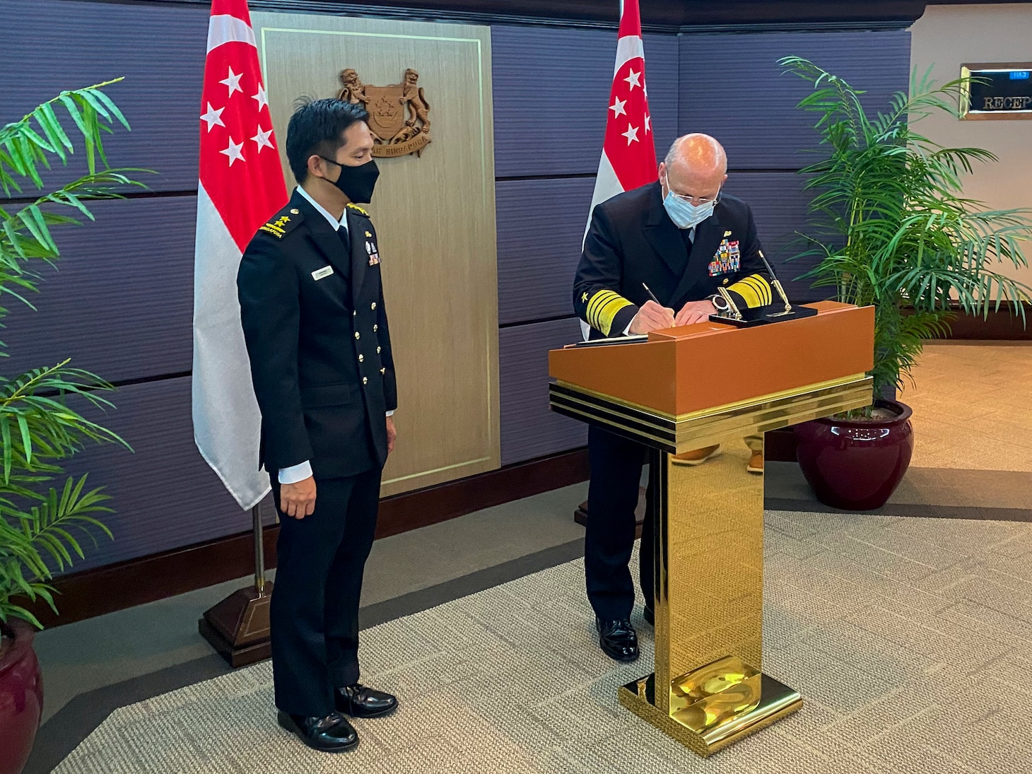 SINGAPORE (July 26, 2021) - Chief of Naval Operations (CNO) Adm. Mike Gildayvisitsthe Singapore Ministry of Defensewith Chief of Navy, Republic of Singapore Navy Rear Adm. Aaron Beng during a trip to the region. Gilday visited the region to meet with senior military and government leadership to reaffirm the U.S. Navy's commitment to our partners and allies and help keep the seas open and free.(U.S. Navy photo by Cmdr. Nate Christensen/Released)