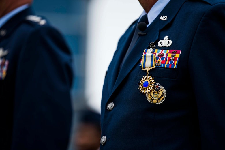 """The Distinguished Service Medal rests upon the uniform of U.S. Air Force Lt. Gen. John F. Thompson, Space and Missile Systems Center commander and Department of the Air Force Program Executive Officer for Space, after being presented by U.S. Space Force Gen. John W. """"Jay"""" Raymond, Chief of Space Operations, during Thompson's retirement ceremony at Los Angeles Air Force Base, California, July 27, 2021. The Air Force Distinguished Service Medal is presented to Airmen and Guardians to recognize distinguished and exceptionally meritorious service to the U.S. while serving in a duty or position of great responsibility. This is Thompson's second time receiving this medal. (U.S. Space Force photo by Staff Sgt. Luke Kitterman)"""