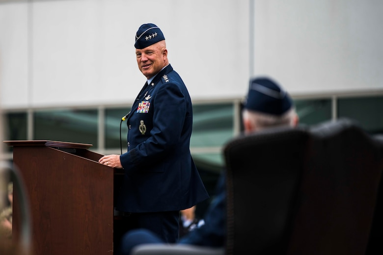 """U.S. Space Force Gen. John W. """"Jay"""" Raymond, Chief of Space Operations, looks back at U.S. Air Force Lt. Gen. John F. Thompson, Space and Missile Systems Center commander and Department of the Air Force Program Executive Officer for Space, during his speech at Thompson's retirement ceremony at Los Angeles Air Force Base, California, July 27, 2021. Raymond was the Presiding Official for the ceremony and spoke on the many accomplishments Thompson has achieved over his career. (U.S. Space Force photo by Staff Sgt. Luke Kitterman)"""