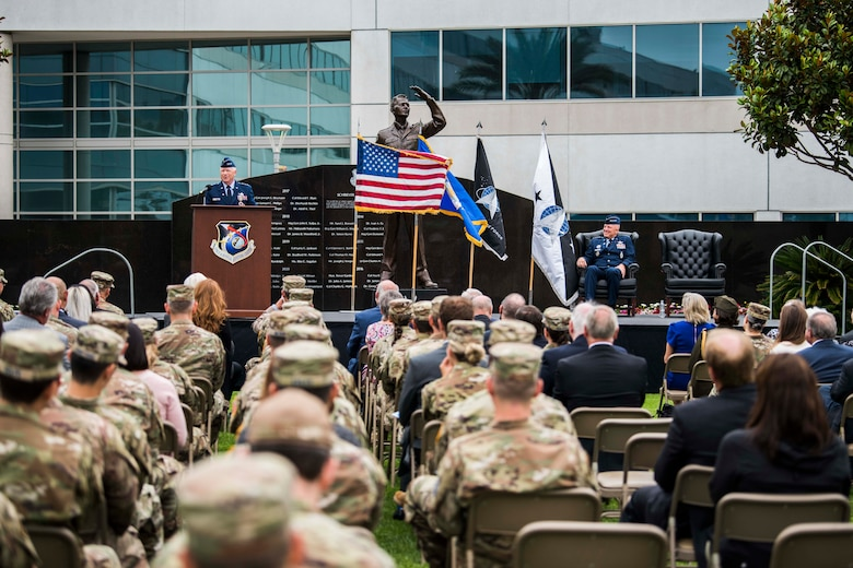 U.S. Air Force Lt. Gen. John F. Thompson, Space and Missile Systems Center commander and Department of the Air Force Program Executive Officer for Space, speaks during his retirement ceremony at Los Angeles Air Force Base, California on July 27, 2021. Thompson thanked his wife, Ruth Anne and children Margaret, Johnny and Claire (who attended virtually), who received certificates of appreciation reflecting their numerous contributions that have made positive impacts to the nation's defense. (U.S. Space Force photo by Staff Sgt. Luke Kitterman)