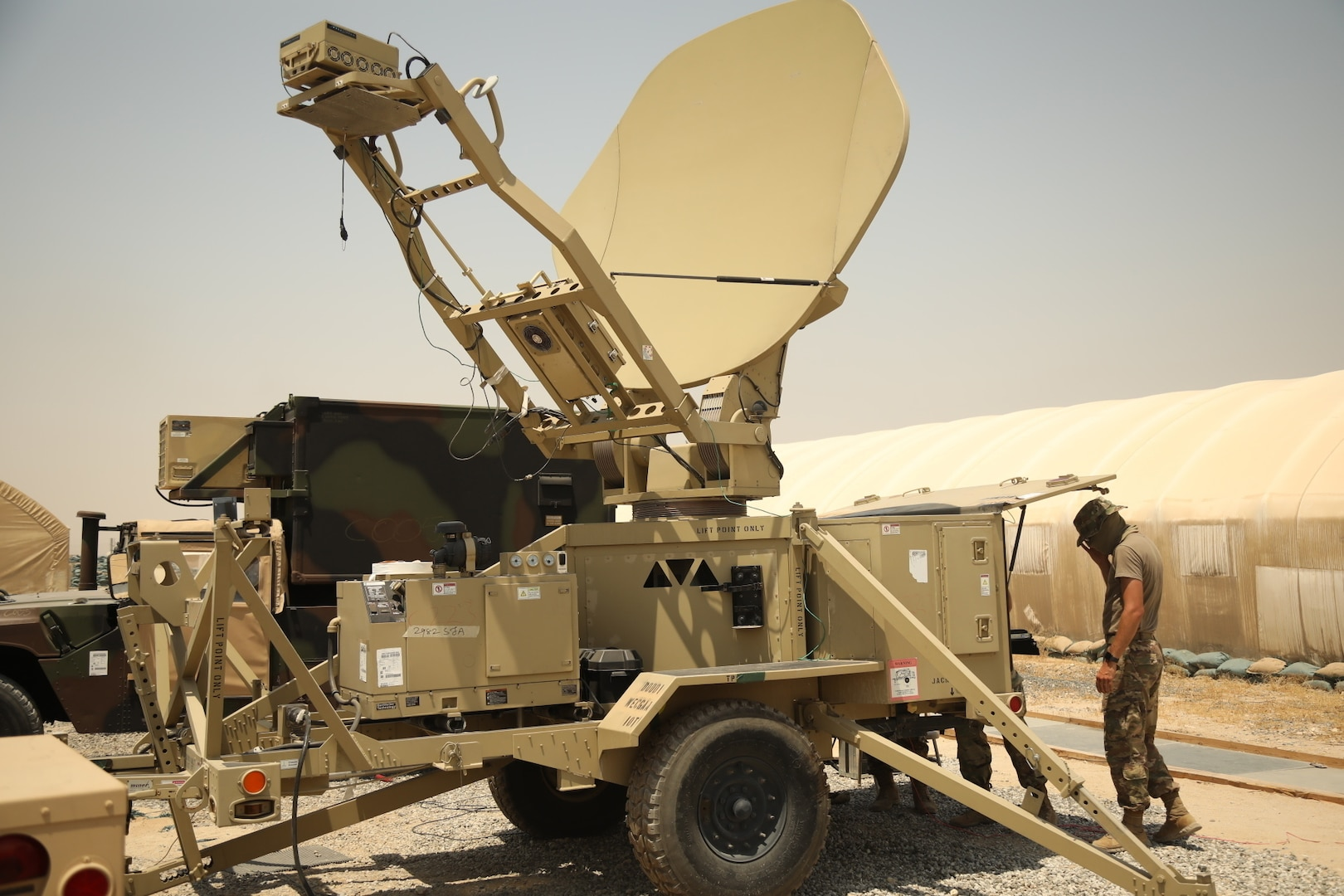 A soldier sets up a satellite.