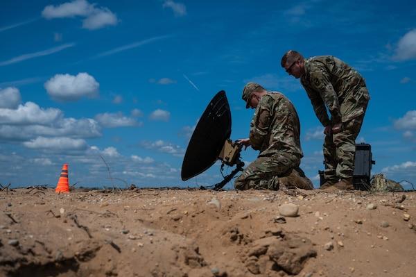 Airmen set up satellite communications.