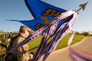 Master Sgt. Glen Kramlinger, 934th Security Forces Squadron plans and programs manger, holds the 934 SFS guidon during a 4.5 mile ruck march in support of the Resolute Defender Ruck Challenge at Minneapolis-St. Paul Air Reserve Station, April 30, 2021. The intent for this 12 month challenge is to build and solidify resiliency, camaraderie, and communication. Currently, 40 Airmen and civilians, comprising 19 different teams, are taking part in the challenge. (Air Force photo by Chris Farley)
