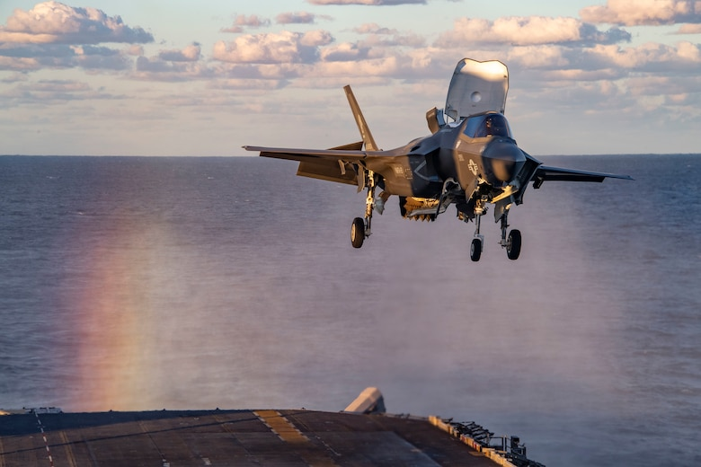 An F-35B Lightning fighter aircraft from the 31st Marine Expeditionary Unit lands on the flight deck of the forward-deployed amphibious assault ship USS America (LHA 6) during Exercise Talisman Sabre 21.