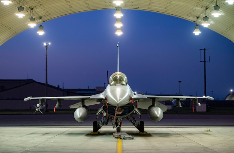 F-16 Fighting Falcon sits in a flow hangar.