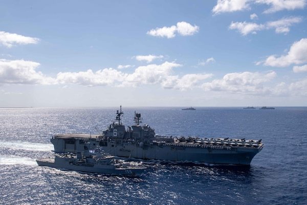 The forward-deployed amphibious assault ship USS America (LHA 6) conducts a fueling-at-sea.