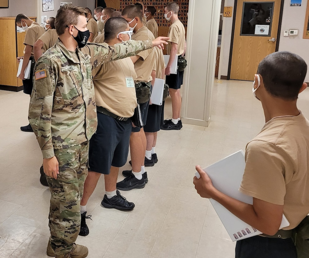 Idaho Army National Guard Pfc. Riley Ward directs candidates at the Idaho Youth ChalleNGe Academy in Pierce, Idaho, July 21, 2021.