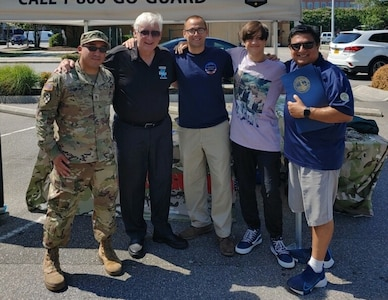 Virginia Army National Guard recruiters participate in Local Heroes Day July 17, 2021, in Virginia Beach, Virginia. Along with local first responders, the recruiters from the  accepted a proclamation and an engraved surfboard from Virginia Beach Mayor Bobby Dyer at the event. (Courtesy Photo)