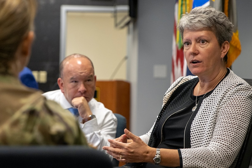 Kim Hood, U.S. Army Financial Management Command Accounting Oversight and Operations division chief, explains what her team is doing to Col. Paige M. Jennings, USAFMCOM commander, and Barry W. Hoffman, USAFMCOM deputy to the commander, during the Army's mock fiscal yearend closeout at the Maj. Gen. Emmett J. Bean Federal Center July 19. Mock yearend is an exercise designed to prepare USAFMCOM and its partners for the fiscal yearend closeout and financial statement preparation at the start of October. (U.S. Army photo by Mark R. W. Orders-Woempner)