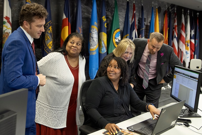 From left to right, Spencer Powell, Joyce Dean, Eddra Peoples, Cynthia Price and Scott Ferge, U.S. Army Financial Management Command systems accountants, talk through a problem during the Army's mock fiscal yearend closeout at the Maj. Gen. Emmett J. Bean Federal Center July 19. Mock yearend is an exercise designed to prepare USAFMCOM and its partners for the fiscal yearend closeout and financial statement preparation at the start of October. (U.S. Army photo by Mark R. W. Orders-Woempner)