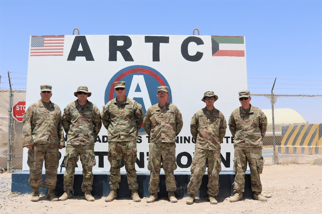 From left, Chief Warrant Officer 4 Douglas Montgomery, Staff Sgt. Richard Recupero, Staff Sgt. Thomas Daniel, Spc. Curtis Hicks, Sgt. Ismael Pulido and Chief Warrant Officer 2 Anthony Meneely pose for a photo after the completion of a Counter Radio-Controlled Improvised Explosive Device Warfare (CREW) course at Camp Buehring, Kuwait.