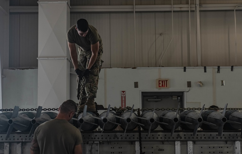 U.S. Air Force Tech. Sgt. Ryan Marler and Tech. Sgt. Jacob Moll, 131st Maintenance Squadron conventional maintenance crew chiefs, prepare live munitions for transport during exercise Quick Fuze at Whiteman Air Force Base, Missouri, July 20, 2021. Exercise Quick Fuze is designed to test the limits of the munitions teams by focusing on producing enough ammunition to fully arm every B-2 Spirit in the inventory.
