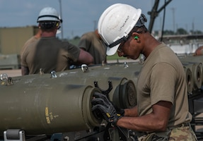 U.S. Air Force Airman 1st Class, Sooraj Thaivalappil, 509th Munitions Squadron conventional maintenance crew chief, prepares the tail end of a Guided Bomb Unit (GBU-38) assembly during exercise Quick Fuze at Whiteman Air Force Base, Missouri, July 20, 2021. Exercise Quick Fuze evaluates the squadron's ability to rapidly produce munitions. Quick Fuze is a routine exercise used to prepare contingency weapons for the B-2 Spirit and maintain operational readiness to effectively support the stealth bomber.