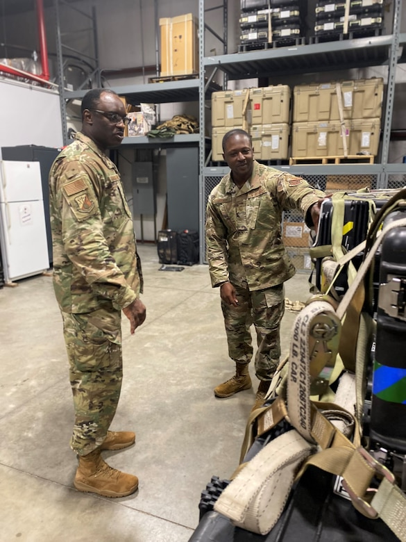Cyrus, shown here with Senior Master Sgt. William Opoku, served as the commander of the 710th Network Operations Squadron at Robins Air Force Base, Georgia, for two years. (Courtesy photo)