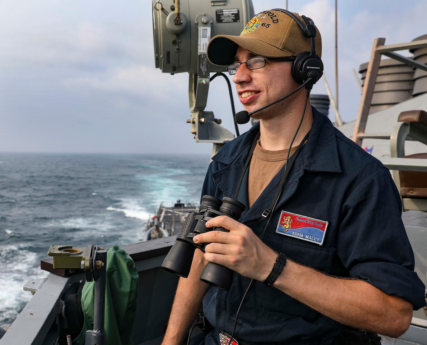 210728-N-FO714-1043 TAIWAN STRAIT (July 28, 2021) Seaman Adam Maley, from Windham, Maine, stands lookout watch on the starboard bridge wing of the Arleigh Burke-class guided-missile destroyer USS Benfold (DDG 65) as the ship transits the Taiwan Strait conducting routine underway operations. Benfold is forward-deployed to the U.S. 7th Fleet area of operations in support of a free and open Indo-Pacific. (U.S. Navy photo by Mass Communication Specialist 1st Class Deanna C. Gonzales)