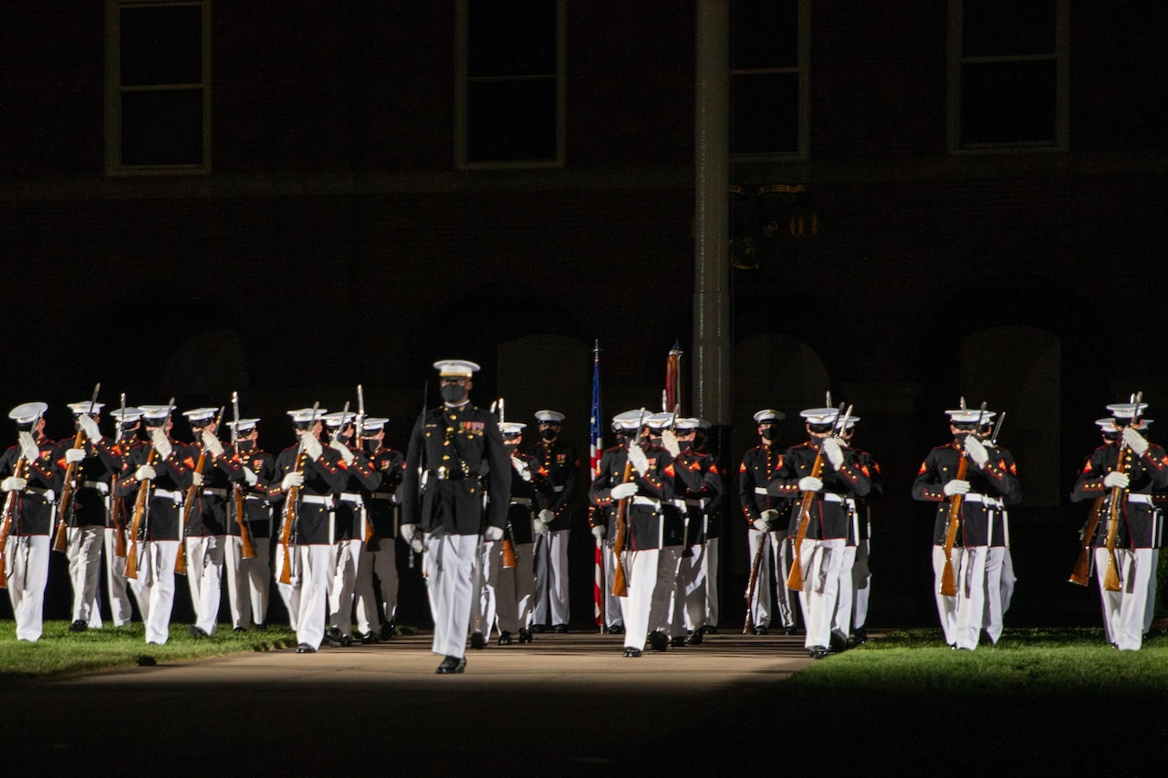 A platoon performs at night.