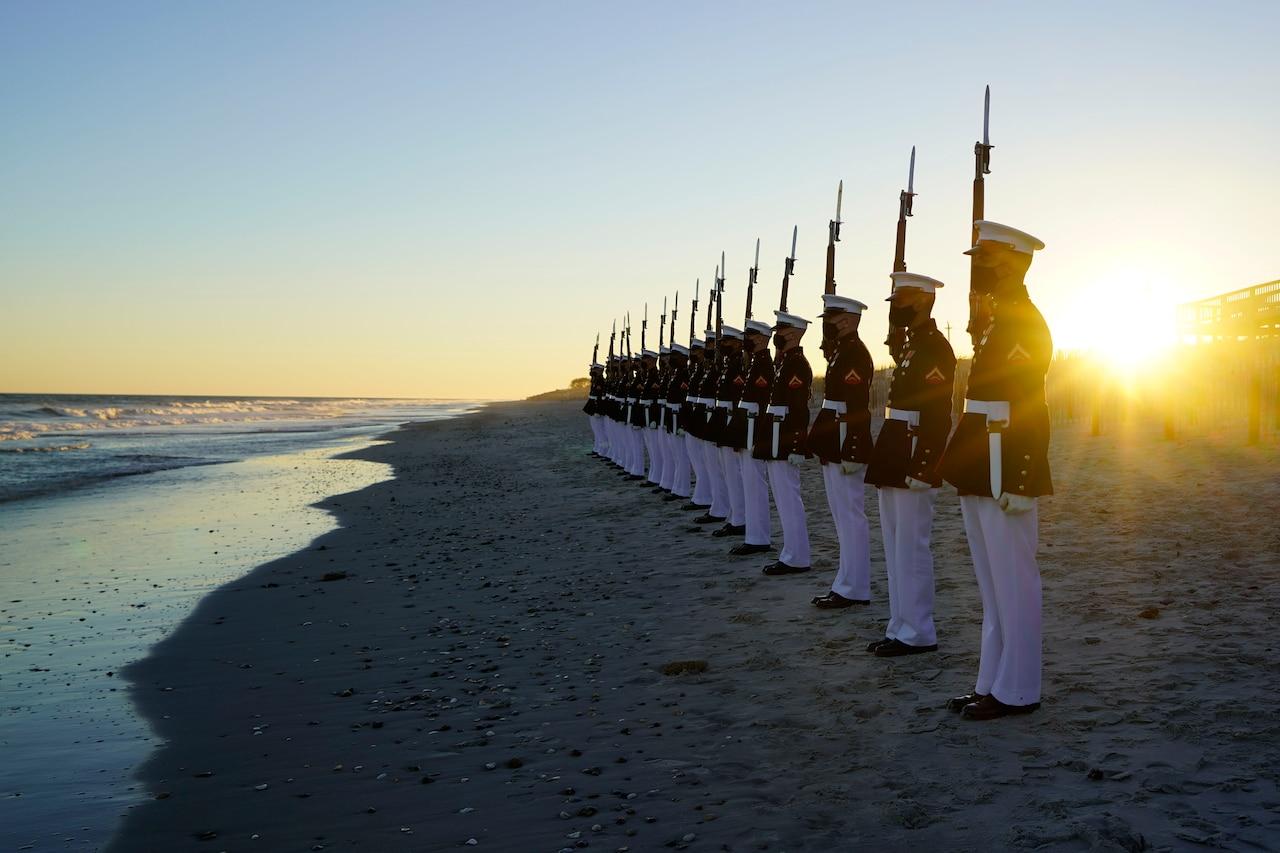 A platoon practices on the beach.