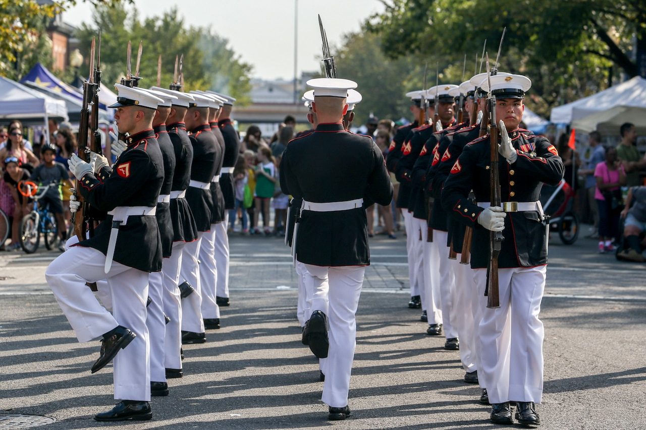 Members of the Marine Corps Silent Drill Platoon perform during a festival.