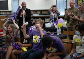 U.S. Air Force Col. Daniel Diehl, 509th Bomb Wing commander, celebrates the win of the Elite Team of the Year award with the Whiteman Elementary students and staff at Whiteman Air Force Base, Missouri, July 21, 2021. The Military Child Education Coalition® announced Whiteman Elementary as the winning school of the organization's annual Student 2 Student® Team of the Year competition, which recognizes school teams' contribution assisting and integrating military students in their classrooms.