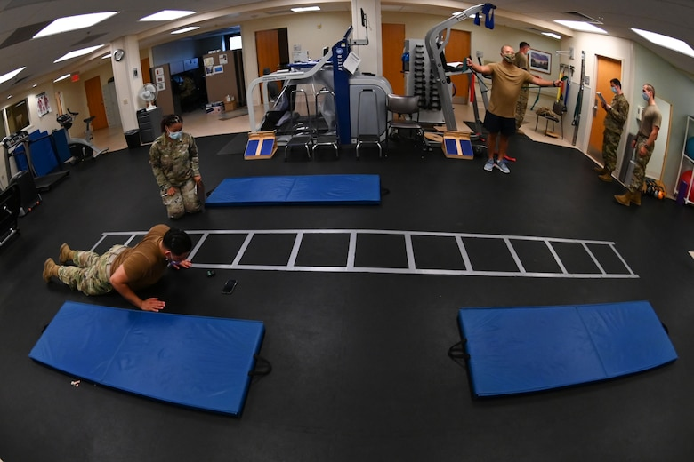 Physical therapy technicians from the 375th Operational Medical Readiness Squadron work with patients on their physical treatment plan at the Physical Therapy Clinic at Scott Air Force Base, Illinois, July 27, 2021. Each patient has an individual treatment plan specifically made for them to follow after an initial assessment by a physical therapist to measure their initial physical baseline. (U.S. Air Force photo by Staff Sgt. Dalton Williams)
