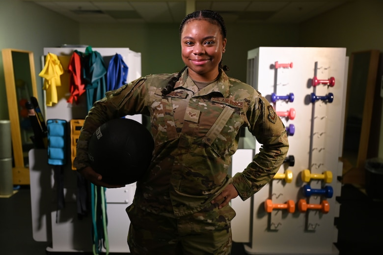 U.S. Air Force Senior Airman Gabrielle Rose, 375th Operational Medical Readiness Squadron physical therapy technician poses for a photo at the Physical Therapy Clinic at Scott Air Force Base, Illinois, July 27, 2021. Rose is part of a team of physical therapy technicians that help to build strength, mobility, balance and other attributes of each clinic patient to enable them to continue their mission. (U.S. Air Force photo by Staff Sgt. Dalton Williams)