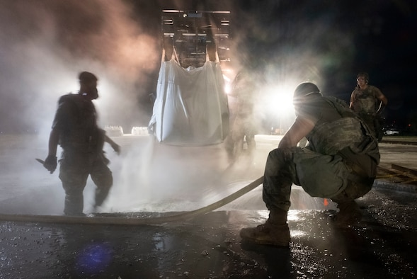 Airmen assigned to the 8th Civil Engineer Squadron fill a crater with water and concrete during a Rapid Airfield Damage Repair training at Kunsan Air Base, Republic of Korea