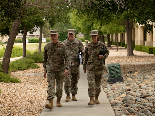 U.S. Air Force Lt. Gen. Robert Miller, Air Force and Space Force Surgeon General, left, along with his executive assistant, Maj. Richard Smith, center, and Chief Master Sgt. Dawn Kolczynski, medical enlisted force and enlisted corps chief, walk outside of base lodging July 27, 2021, at Travis Air Force Base, California.