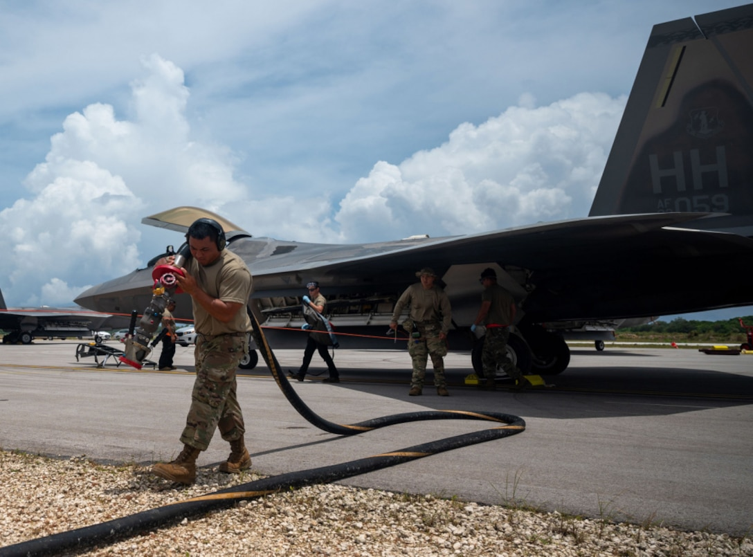 U.S. Air Force crew chiefs assigned to the 154th Aircraft Maintenance Squadron, Air National Guard Hawaii, refuel a F-22 Raptor in support of Architecture Demonstration and Evaluation 5.2 during operation Pacific Iron 21 at Northwest Field, Guam, July 26, 2021. ADE 5.2 is part of the fifth in a series of Architecture Demonstration and Evaluation events conducted by the Department of the Air Force Chief Architect's Office. (U.S. Air Force photo by Senior Airman Alexandra Minor)