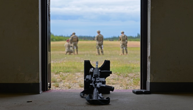 Airmen from the 354th Security Forces Squadron (SFS) fire M4 carbines during a new Security Forces Qualification Course on Eielson Air Force Base, Alaska, July 14, 2021. The 354th SFS Combat Arms instructors have been tasked with training this new course to Defenders on Eielson. (U.S. Air Force photo by Senior Airman Beaux Hebert)