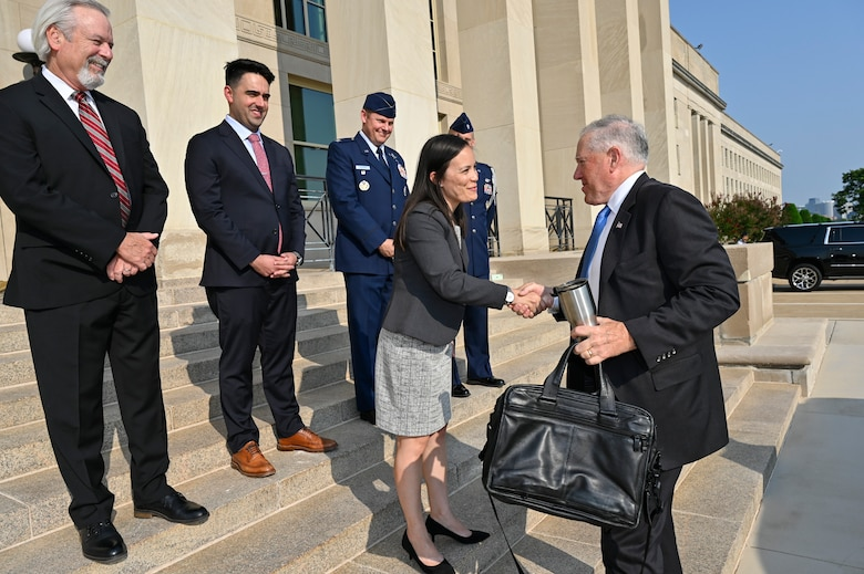 Secretary of the Air Force Frank Kendall shakes hands with Under Secretary of the Air Force Gina Ortiz Jones on arrival for his first day at the Pentagon, Arlington, Va., July 28, 2021. (U.S. Air Force photo by Eric Dietrich)
