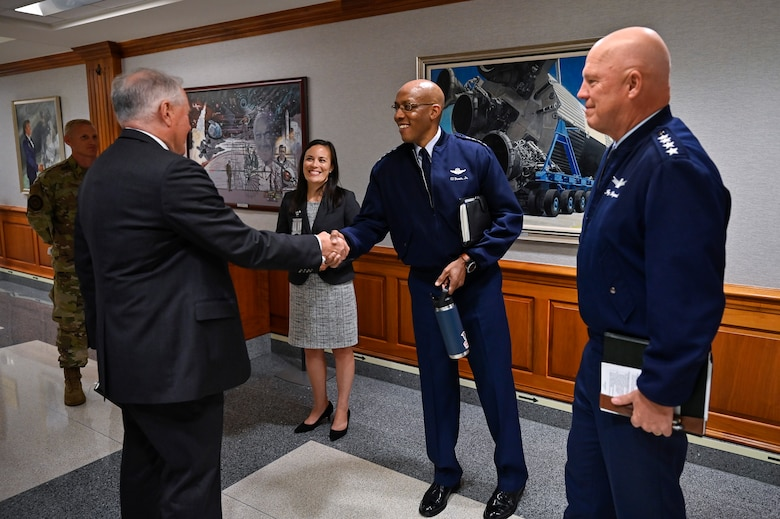 """Secretary of the Air Force Frank Kendall shakes hands with Air Force Chief of Staff Gen. CQ Brown, Jr., before a meeting with Under Secretary of the Air Force Gina Ortiz Jones, Brown, and Chief of Space Operations Gen. John W. """"Jay"""" Raymond at the Pentagon, Arlington, Va., July 28, 2021. (U.S. Air Force photo by Eric Dietrich)"""