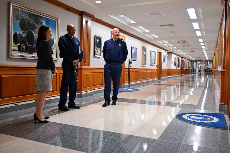 """Under Secretary of the Air Force Gina Ortiz Jones, Air Force Chief of Staff Gen. CQ Brown, Jr., and Chief of Space Operations Gen. John W. """"Jay"""" Raymond talk prior to a meeting with Secretary of the Air Force Frank Kendall at the Pentagon, Arlington, Va., July 28, 2021. (U.S. Air Force photo by Eric Dietrich)"""