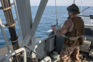210721-A-UH336-0106 ARABIAN GULF (July 21, 2021) – Marine Cpl. Robert Van Pelt, observes targets aboard patrol coastal ship USS Tempest (PC 2) during a multilateral air operations in support of maritime surface warfare (AOMSW) exercise in the Arabian Gulf, July 21. Commander, Task Force 55 operates in the U.S. 5th Fleet area of operations in support of naval operations to ensure maritime stability and security in the Central Region, connecting the Mediterranean and Pacific through the western Indian Ocean and three critical chokepoints to the free flow of global commerce. (U.S. Army photo by Spc. Joseph DeLuco)