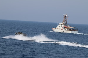 210721-N-N0146-1001 ARABIAN GULF (July 21, 2021) – Royal Navy and U.S. Navy Sailors operate a rigid hull inflatable boat with Coast Guard patrol boat USCGC Maui (WPB 1304) during a multilateral air operations in support of maritime surface warfare (AOMSW) exercise in the Arabian Gulf, July 21. Maui is deployed to the U.S. 5th Fleet area of operations in support of naval operations to ensure maritime stability and security in the Central Region, connecting the Mediterranean and Pacific through the western Indian Ocean and three strategic choke points. (U.S. Coast Guard photo by Petty Officer 2nd Class Joseph Perrone)