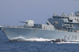 210721-N-N0146-1005 ARABIAN GULF (July 21, 2021) – Royal Navy and U.S. Navy Sailors operate a rigid hull inflatable boat in formation with Royal Navy frigate HMS Montrose (F236) during a multilateral air operations in support of maritime surface warfare (AOMSW) exercise in the Arabian Gulf, July 21. (U.S. Coast Guard photo by Petty Officer 2nd Class Joseph Perrone)