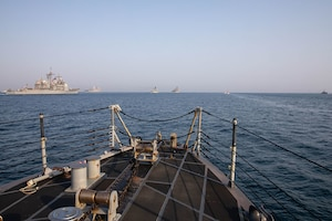 210722-A-UH336-0019 ARABIAN GULF (July 22, 2021) – Guided-missile destroyer USS Mitscher (DDG 57), Royal Navy frigate HMS Montrose (F236), amphibious transport dock ship USS San Antonio (LPD 17), amphibious dock landing ship USS Carter Hall (LSD 50), Coast Guard fast response cutter USCGC Robert Goldman (WPC 1142), Coast Guard patrol boat USCGC Maui (WPB 1304), and patrol coastal ship USS Chinook (PC 9) operate in formation during a multilateral air operations in support of maritime surface warfare (AOMSW) exercise in the Arabian Gulf, July 22. Commander, Task Force 55 operates in the U.S. 5th Fleet area of operations in support of naval operations to ensure maritime stability and security in the Central Region, connecting the Mediterranean and Pacific through the western Indian Ocean and three critical chokepoints to the free flow of global commerce. (U.S. Army photo by Spc. Joseph DeLuco)