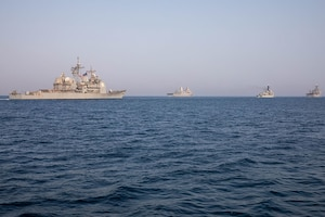 210722-A-UH336-0032 ARABIAN GULF (July 22, 2021) – Guided-missile destroyer USS Mitscher (DDG 57), amphibious transport dock ship USS San Antonio (LPD 17), amphibious dock landing ship USS Carter Hall (LSD 50), and Coast Guard fast response cutter USCGC Charles Moulthrope (WPC 1141) operate in formation during a multilateral air operations in support of maritime surface warfare (AOMSW) exercise in the Arabian Gulf, July 22. Commander, Task Force 55 operates in the U.S. 5th Fleet area of operations in support of naval operations to ensure maritime stability and security in the Central Region, connecting the Mediterranean and Pacific through the western Indian Ocean and three critical chokepoints to the free flow of global commerce. (U.S. Army photo by Spc. Joseph DeLuco)