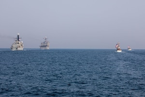 210722-A-UH336-0074 ARABIAN GULF (July 22, 2021) – Royal Navy frigate HMS Montrose (F236), amphibious dock landing ship USS Carter Hall (LSD 50), Coast Guard fast response cutter USCGC Robert Goldman (WPC 1141), and Coast Guard patrol boat USCGC Monomoy (WPB 1326) operate in formation during a multilateral air operations in support of maritime surface warfare (AOMSW) exercise in the Arabian Gulf, July 22. Commander, Task Force 55 operates in the U.S. 5th Fleet area of operations in support of naval operations to ensure maritime stability and security in the Central Region, connecting the Mediterranean and Pacific through the Western Indian Ocean and three critical chokepoints to the free flow of global commerce. (U.S. Army photo by Spc. Joseph DeLuco)