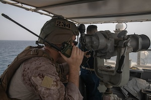 210722-A-UH336-0089 ARABIAN GULF (July 22, 2021) – Marine Cpl. Robert Van Pelt, observes targets aboard patrol coastal ship USS Tempest (PC 2) during a multilateral air operations in support of maritime surface warfare (AOMSW) exercise in the Arabian Gulf, July 22. Commander, Task Force 55 operates in the U.S. 5th Fleet area of operations in support of naval operations to ensure maritime stability and security in the Central Region, connecting the Mediterranean and Pacific through the western Indian Ocean and three critical chokepoints to the free flow of global commerce. (U.S. Army photo by Spc. Joseph DeLuco)