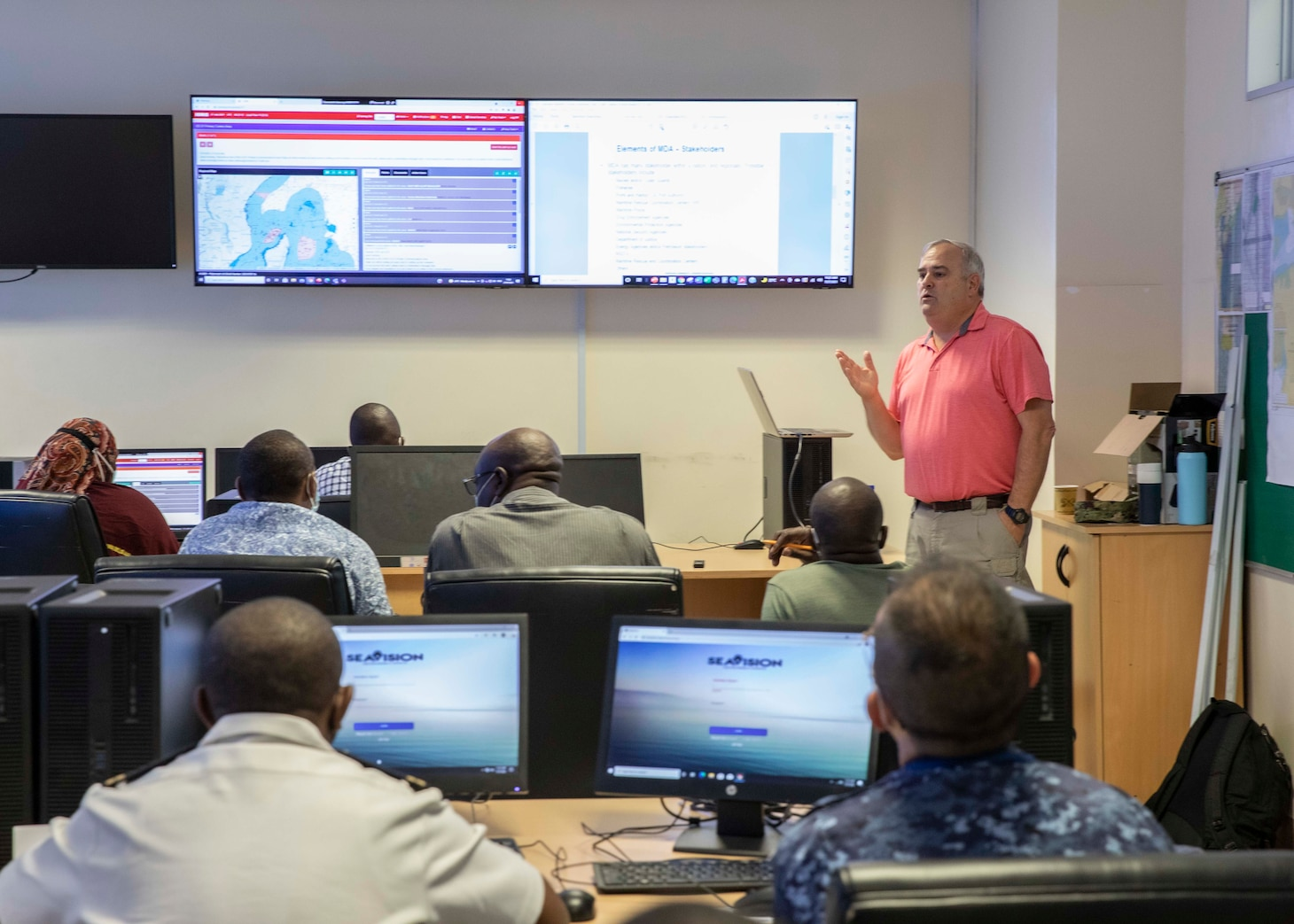 (July 27, 2021)  David Rollo, U.S. Naval Forces Europe-Africa maritime domain awareness program manager, provides the joint operations center personnel with a brief on SeaVision during exercise Cutlass Express 2021, in Mombasa, Kenya, July 27, 2021. Cutlass Express is designed to improve regional cooperation, maritime domain awareness and information sharing practices to increase capabilities between the U.S., East African and Western Indian Ocean nations to counter illicit maritime activity.