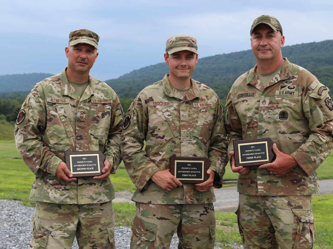 The top three winners of the 2021 Governor's Twenty competition celebrate their achievement July 24 at Fort Indiantown Gap. Staff Sgt. Nicholas Yackovich (center), with the 171st Security Forces Squadron, 171st Air Refueling Wing, Pennsylvania Air National Guard of Harrison City, Pa.; Chief Master Sgt. Edwards Altmeyer (left), with the 171st SFS of Coraopolis, Pa.; and Staff Sgt. Douglas Costello (right), with the 213th Personnel Company, 213th Regional Support Group, Pennsylvania Army National Guard of Mountain Top, Pa., placed first, second and third. Eighty-three Pennsylvania National Guard Soldiers and Airmen competed with rifles and pistols in multiple courses of fire to determine the Commonwealth's best marksmen during the Governor's Twenty match July 23-24. (U.S. Army National Guard photo by Spc. Vail Forbeck)