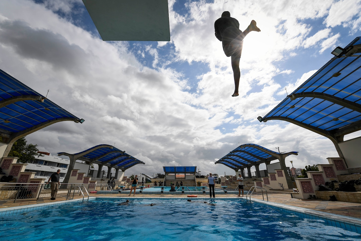 (July 28, 2021) A Mozambique Sailor jumps off a high dive as part of water survival training during exercise Cutlass Express 2021 at the Bandari Maritime Academy in Mombasa, Kenya, July 28, 2021. Cutlass Express is designed to improve regional cooperation, maritime domain awareness and information sharing practices to increase capabilities between the U.S., East African and Western Indian Ocean nations to counter illicit maritime activity.