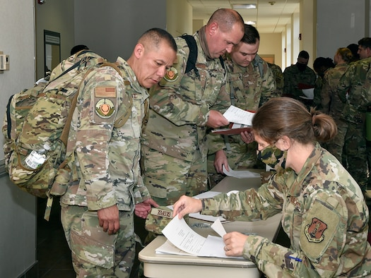 Members of the 127th Security Forces Squadron, Selfridge Air National Guard Base, Michigan, check in with leadership prior to inprocessing at Alpena Combat Readiness Training Center here on July 27, 2021. The defenders arrived to participate in Exercise Spartan, a two weeks long exercise meant to demonstrate the unit's capability to operate in a contested, degraded and operationally-limited environment, against a near-peer adversary.