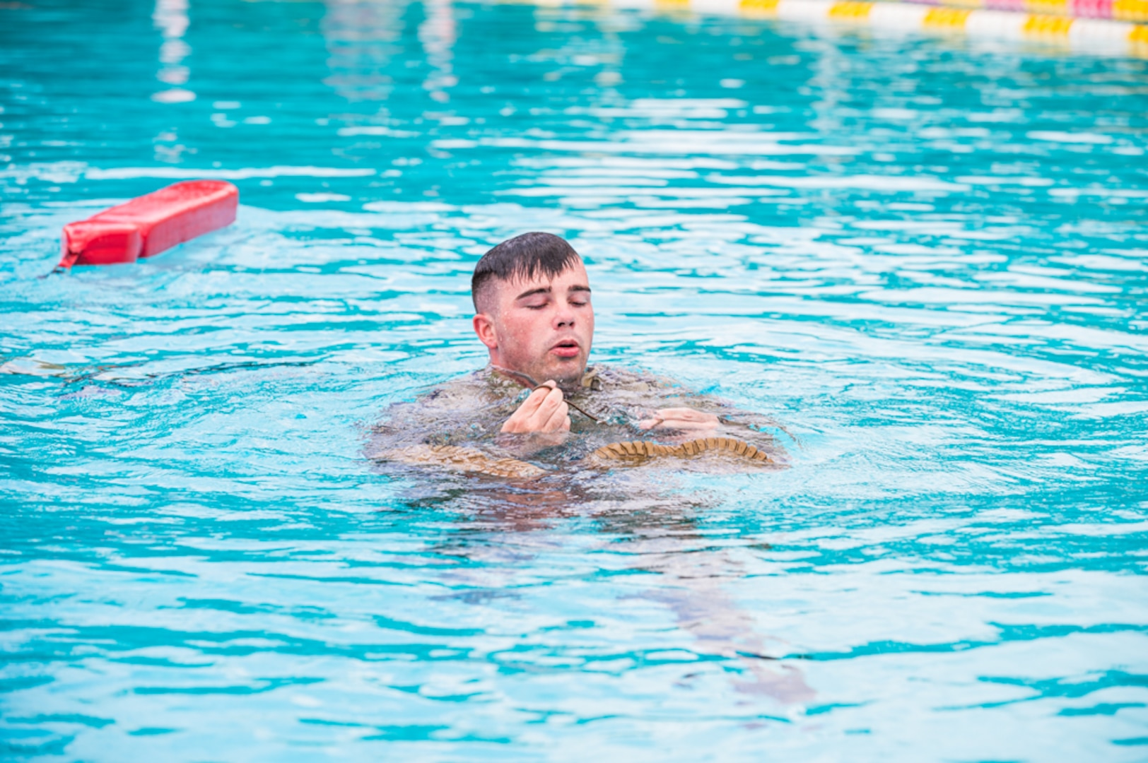 Army Staff Sgt. Edward Nelan competes in the water survival portion of the 2021 U.S. Army Medical Command Best Leader Competition on July 26, 2021.