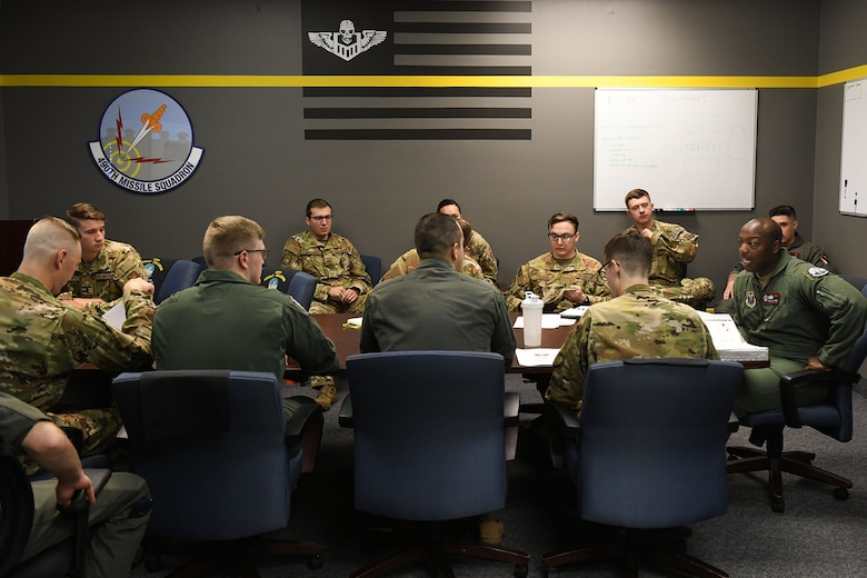Missileers from the 12th Missile Squadron attend a deployment briefing in preparation to travel to the missile field July 21, 2021, at Malmstrom Air Force Base, Mont.