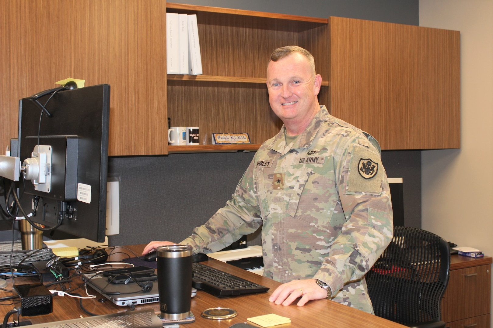 Army Brigadier General Eric Shirley stands at his desk
