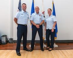 Airmen posing for photo.