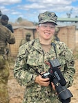 Mass Communication Specialist 1st Class Jen S. Martinez, a member of the Combined Joint Information Bureau, covers U.S. Marines and Australian Defence Force during a combined urban clearance during Exercise Talisman Sabre 21 in Townsville Training Area, Queensland, Australia, July 27, 2021. She is a Navy Reservist with Navy Office of Information, U.S. Pacific Fleet, and is on her first annual training. Australian and U.S. Forces combine biennially for Talisman Sabre, a month-long multi-domain exercise that strengthens allied and partner capabilities to respond to the full range of Indo-Pacific security concerns. (U.S. Navy photo by Lt. Travis Weger)