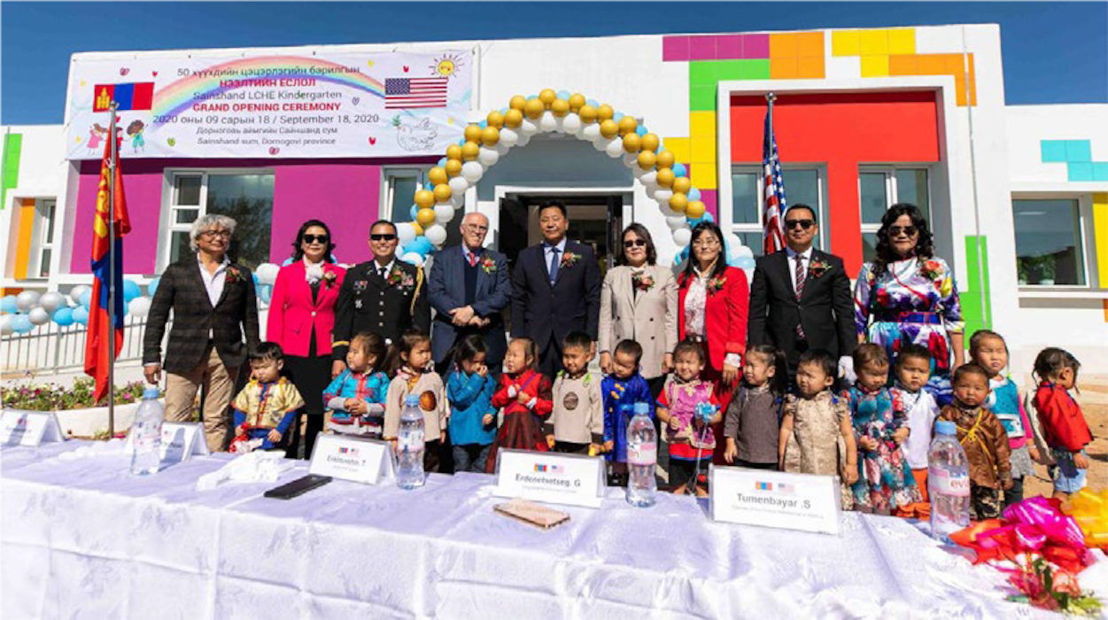 Members of the U.S. Embassy in Mongolia participate in a turnover ceremony for the Sainshand kindergarten on Sept. 18, 2020, in the Dornogovi Province of Mongolia. The U.S. Army Corps of Engineers – Alaska District oversaw the design and construction of the facility. Hon. Michael Klecheski, U.S. Ambassador to Mongolia, attends the ceremony with the Sainshand assistant governor, Dornogovi Governor, Provincial Ministry of Education officials, school headmistress, Mongolian Properties development manager, kindergartners and others. (Photo credit: U.S. Embassy – Mongolia, Public Affairs Section.)
