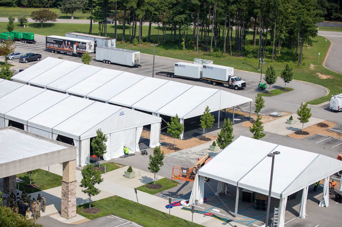 Civilian contractors building support structures for Operation Allied Refugee on 26th, July, 2021 at Fort Lee, Virginia.